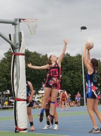 Two girls playing netball